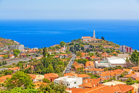 horizont: Funchal, Madeira - June 7, 2013: Church of Sao Martinho - a civil parish in the municipality of Funchal. View from Pico dos Barcelo - south coast of Madeira - Atlantic Ocean in the background. Editorial