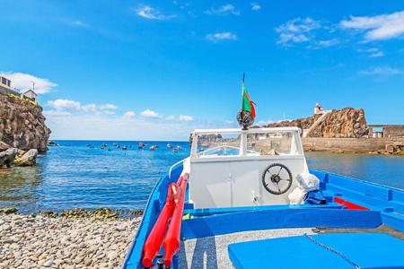 bulkhead: Boat at the harbor  at land - ocean in front - Camara de Lobos, Madeira Editorial