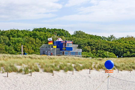 Graal-Mueritz, Germany - June 14, 2012: Modern lifeguard station of DLRG (Deutsche Lebens-Rettungs-Gesellschaft) at beach in Graal-Mueritz