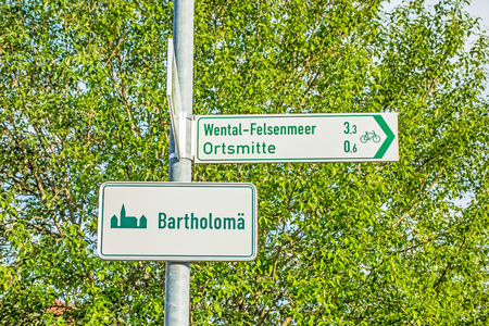 bikeway: Town sign of Bartholomae, Swabia Alps - way to Wental Felsenmeer - town  village centre Stock Photo