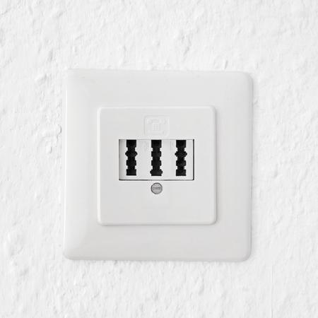 telephone jack  socket on white wall