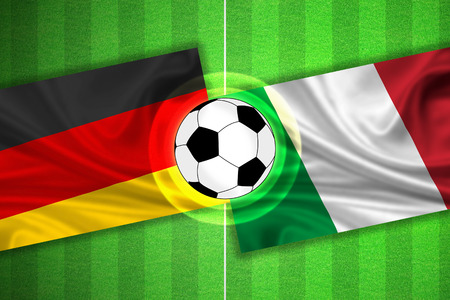 soccer wm: green Soccer  Football field with stripes and flags of germany - italy, and ball. Stock Photo