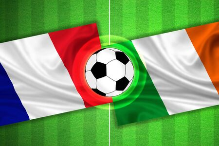 penalty flag: green Soccer  Football field with stripes and flags of france - ireland, and ball. Stock Photo