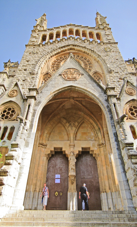 Soller, Majorca, Spain - June 23, 2008: Church of Soller Sant Bartomeu, Majorca - front view. People at the entrance portal doors.