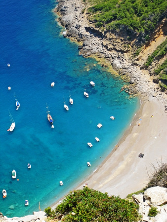 Coll Baix beach  playa, Majorca, Spain - bay with clear turquoise water - detail view from above during hiking tour
