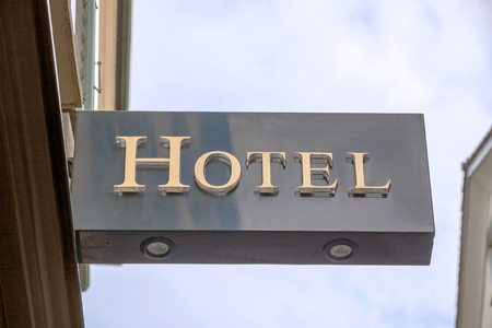single word: Hotel sign, metal letters, blue sky Stock Photo