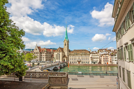 poi: Church Fraumunster in Zurich, Switzerland - view from Minster Grossmunster square