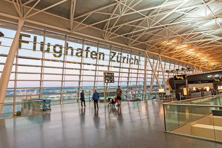 Zurich, Switzerland - June 11, 2017: Airport Zurich (Flughafen Zurich) waiting area after check-in - view towards airfield Éditoriale