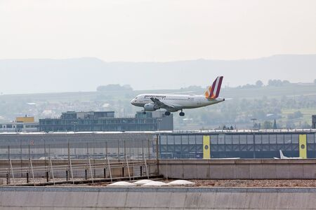 despatch: Stuttgart, Germany - May 06, 2017: Germanwings Airbus A319 airplane during landing at airport Stuttgart, Germany