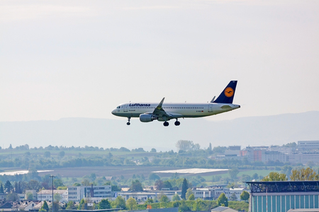 despatch: Stuttgart, Germany - May 06, 2017: Lufthansa Airlines Airbus A320-200 airplane during landing at airport Stuttgart