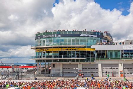 Nurburg, Germany - May 20, 2017: Fishermens Friend Strongman RUN at race track Nurburgring - runners waiting for start on start finishing straight in front of Mercedes  AMG lounge tower Editorial