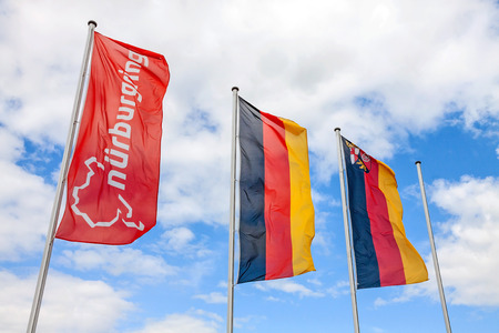 Nurburg, Germany - May 20, 2017: Flag at race track Nurburgring, labeled with Nurburgring and logo, two german flags at pole Editorial