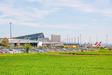 Stuttgart, Germany - May 06, 2017: Airport Stuttgart, Terminal, exterior view with green field in foreground Editorial