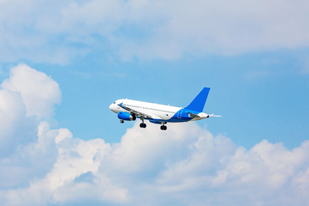 despatch: airplane in flight - blue sky with clouds Stock Photo