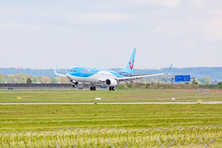 airstrip: Stuttgart, Germany - April 29, 2017: Airbus airplane A320 from TUIfly on landing approach to airport Stuttgart - green meadow with weather station in front