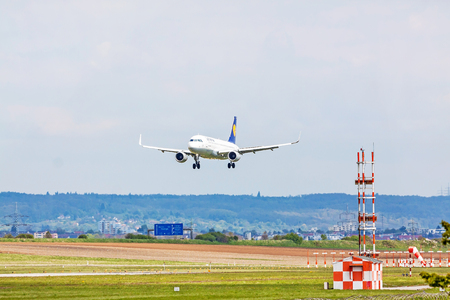 despatch: Stuttgart, Germany - April 29, 2017: Airbus airplane A320 200 from Lufthansa on landing approach to airport Stuttgart - green meadow with weather station in front Editorial