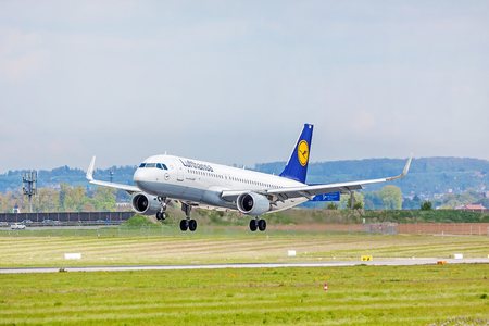 despatch: Stuttgart, Germany - April 29, 2017: Airbus airplane A320 200 from Lufthansa on landing approach to airport Stuttgart - runway and green meadow in front Editorial