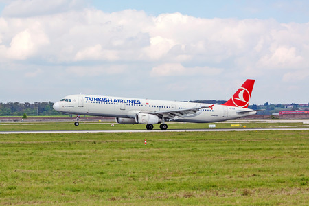 despatch: Stuttgart, Germany - April 29, 2017: Airbus airplane A321 from Turkish Airlines on landing approach at airport Stuttgart - runway and green meadow in front
