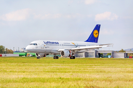 despatch: Stuttgart, Germany - April 29, 2017: Airbus airplane A319-100 from Lufthansa on runway, airport Stuttgart - meadow in front
