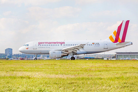 Stuttgart, Germany - April 29, 2017: Airbus airplane A319-100 from Germanwings  Lufthansa Group on runway, airport Stuttgart - meadow in front