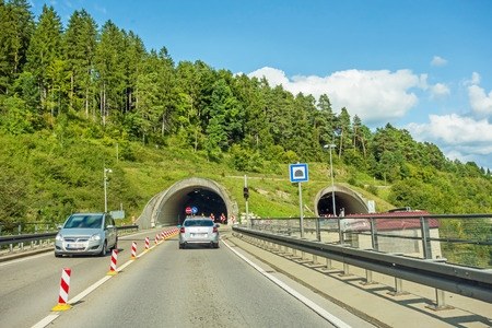 cars at tunnel entrance  exit on highway, german autobahn Stock Photo