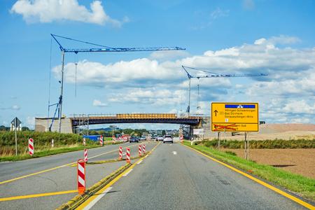 bridge reconstruction over federal highway B27 direction Villingen-Schwenningen. Road with cars and cranes.