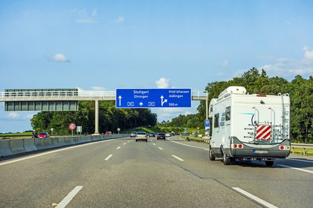 camping van driving on freeway direction Stuttgart on motorway / german autobahn A81 - exit Hildrizhausen Фото со стока - 85364317