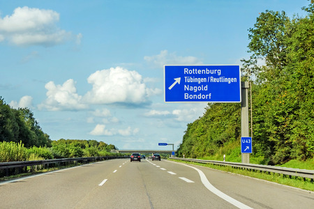 motorway road sign on (Autobahn 81 / A 81 / E 531) direction to city Herrenberg / Stuttgart - exit Rottenburg / Tubingen / Reutlingen / Nagold / Bondorf 写真素材