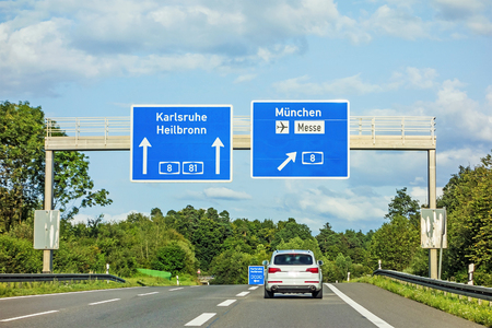 motorway road sign on (Autobahn A 81  A 8) directions Karlsruhe  Heilbronn - exit A 8 to Munich  Airport  Messe