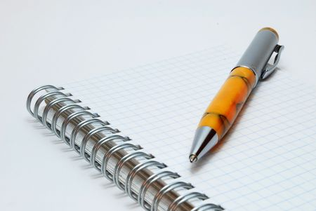 Isolated Ballpoint Pen on Spiral Notebook Stock Photo