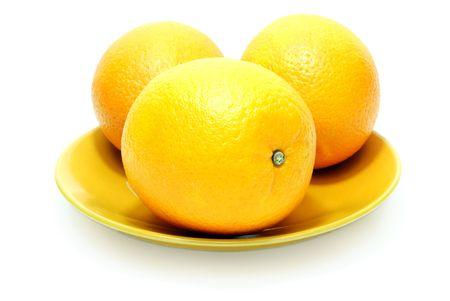 Three Isolated Oranges on White Background
