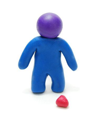 plasticine: 3D Blue Plasticine Man Figure Standing  in Sadness near Dropped Red Heart