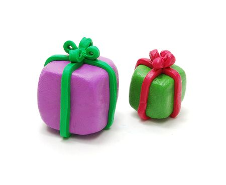 Two 3D Colored Christmas Gifts Made of Plasticine Isolated on White Background photo