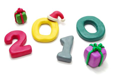 3D New Year Text 2010 Laying Random with Gifts Made of Colored Plasticine Isolated on White Background