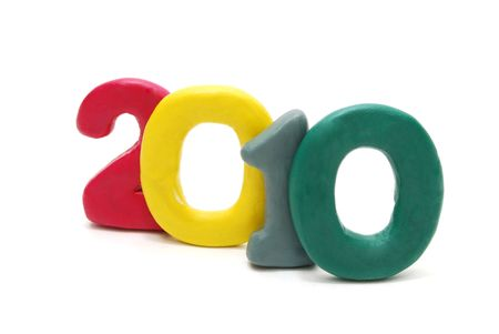 3D New Year Text 2010 Made of Colored Plasticine Isolated on White Background photo