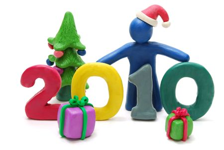 3D New Year Text 2010 Made of Colored Plasticine with Christmas Gifts and Tree Isolated on White Background photo