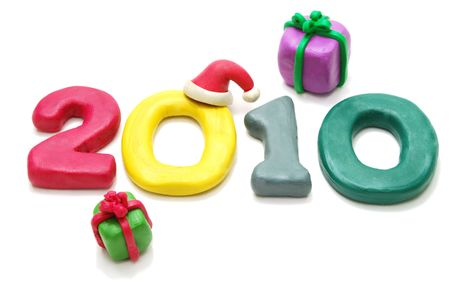 3D New Year Text 2010 Made of Colored Plasticine with Gifts Isolated on White Background