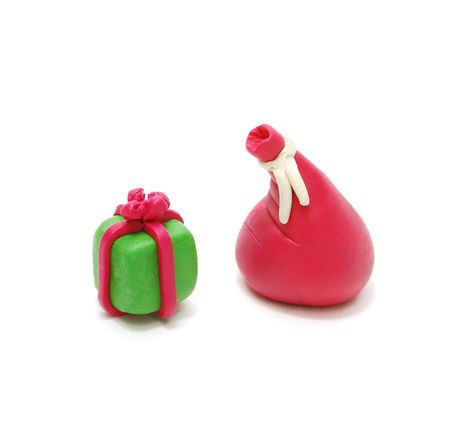 3D Christmas Gift and Red Santas Sack Made of Plasticine Isolated on White Background Stock Photo