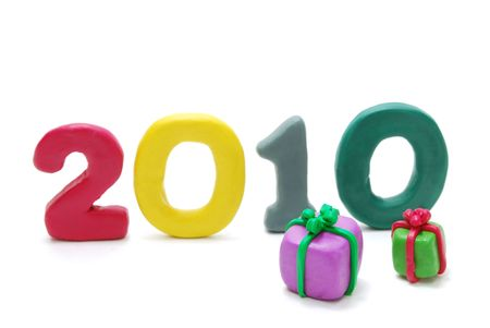 3D New Year Text 2010 Made of Colored Plasticine with Gifts Isolated on White Background Stock Photo - 6073401