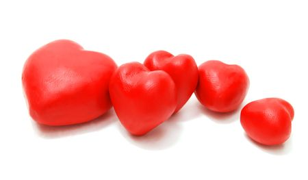 Valentines 3D Red Hearts Laying Random Made of Clay Isolated on White Background photo
