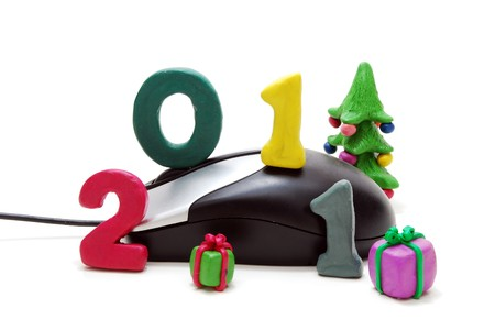 3D New Year Text 2011 with Christmas Tree and Gifts Made of Colored Plasticine and Computer Mouse Isolated on White Background