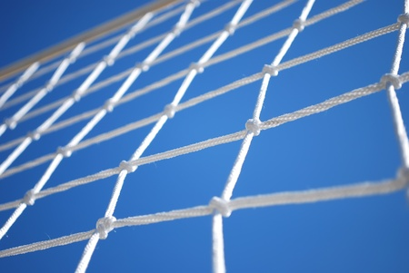 in net: Part of Volleyball Net with Clear Blue Sky on Background
