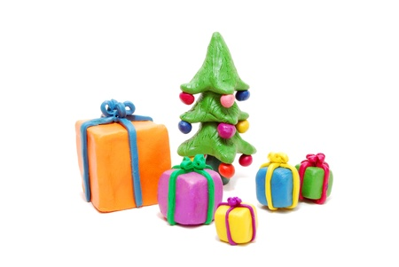 Various Gift Boxes and Christmas Tree Isolated on White