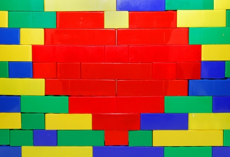 Red Heart Shape of Lego Blocks on the Lego Wall Stock Photo