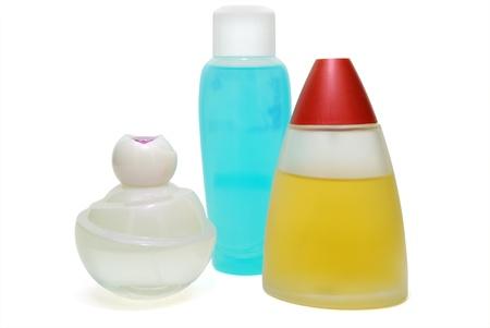 Three Parfume Flasks of Fragrance Isolated on White Stock Photo