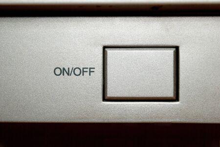 Square Silver On Off Switch Button Closeup Standard-Bild
