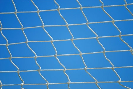 Valleyball Net Strings over Blue Sky Background