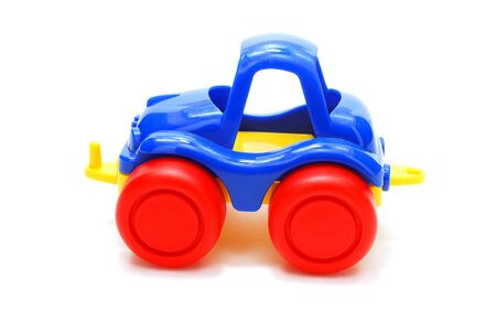 Tiny Blue Car Toy with Red Wheels Isolated on White