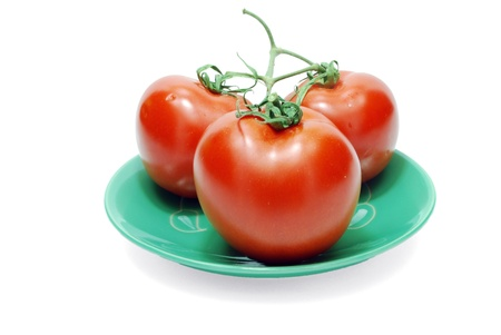 Isolated Three Red Tomatoes on Plate on White