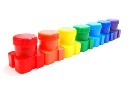 Set of Colored Ink  Paint  Cans in Row Isolated on White Stock Photo